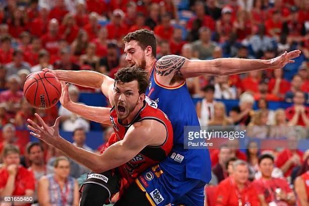 Angus Brandt of the Wildcats is fould driving to the basket by Eric Jacobsen of the 36ers during the round 15 NBL match between the Perth Wildcats...