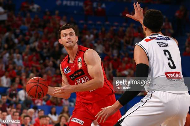 Angus Brandt of the Wildcats looks to pass the ball during the round three NBL match between the Perth Wildcats and Melbourne United at Perth Arena...