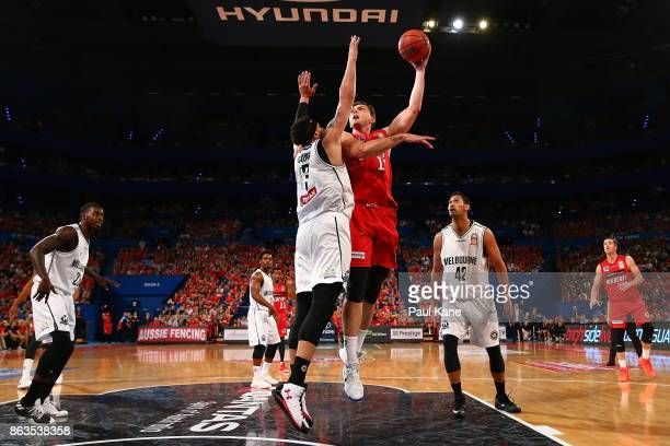 Angus Brandt of the Wildcats puts a shot up against Josh Boone of United during the round three NBL match between the Perth Wildcats and Melbourne...