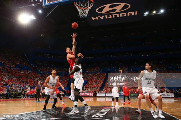 Angus Brandt of the Wildcats puts a shot up against Majok Majok of United during the round three NBL match between the Perth Wildcats and Melbourne...