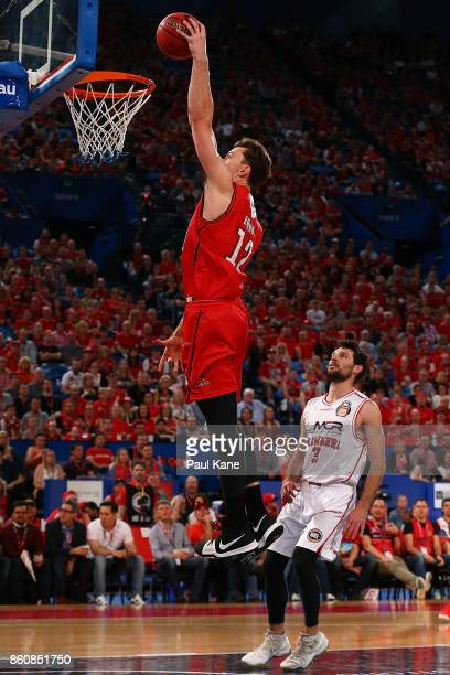 Angus Brandt of the Wildcats sets for a dunk during the round two NBL match between the Perth Wildcats and the Illawarra Hawks at Perth Arena on...