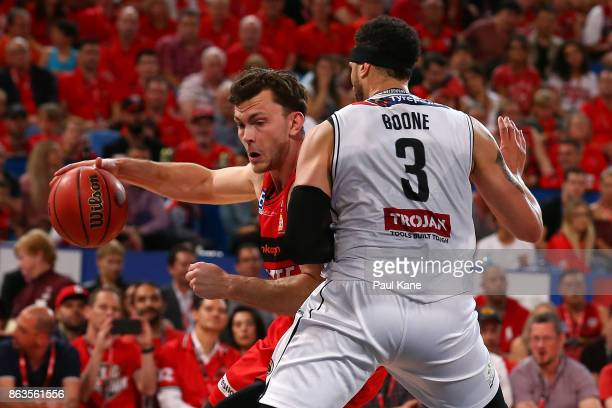 Angus Brandt of the Wildcats works to the basket against Josh Boone of United during the round three NBL match between the Perth Wildcats and...