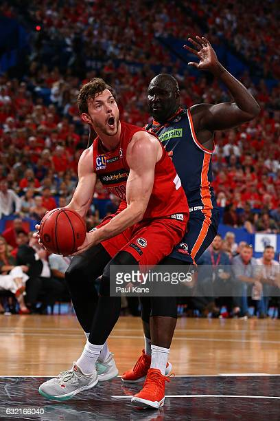 Angus Brandt of the Wildcats works to the basket against Nathan Jawai of the Taipans during the round 16 NBL match between the Perth Wildcats and the...
