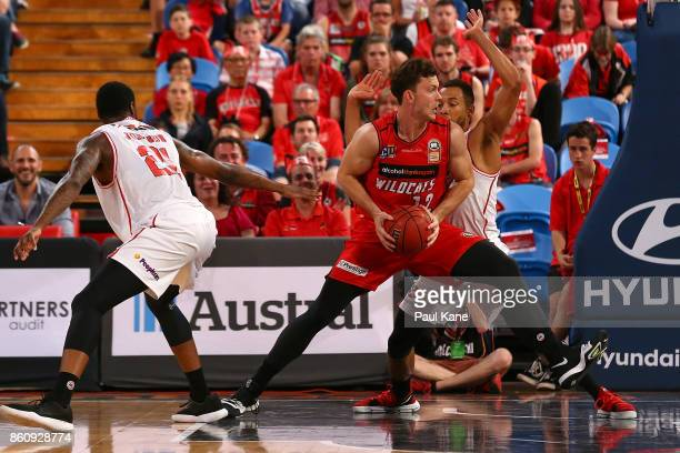 Angus Brandt of the Wildcats works to the basket during the round two NBL match between the Perth Wildcats and the Illawarra Hawks at Perth Arena on...