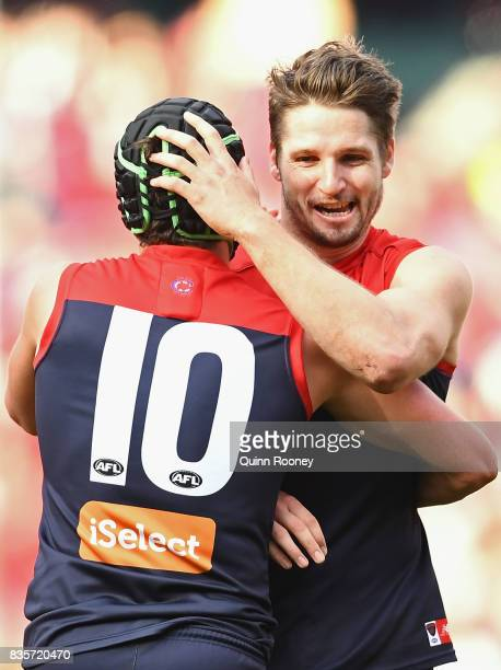 Angus Brayshaw and Jesse Hogan of the Demons celebrate a goal during the round 22 AFL match between the Melbourne Demons and the Brisbane Lions at...