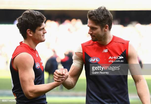 Angus Brayshaw and Jesse Hogan of the Demons celebrate winning the round 22 AFL match between the Melbourne Demons and the Brisbane Lions at...