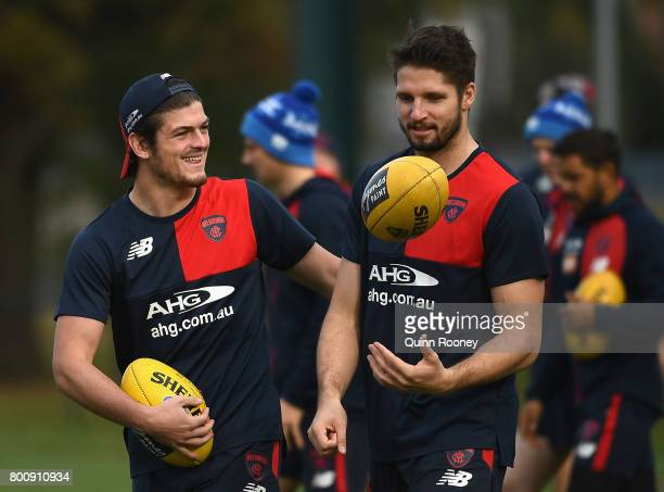 Angus Brayshaw and Jesse Hogan of the Demons have a laugh during a Melbourne Demons AFL training session at Gosch's Paddock on June 26 2017 in...