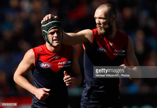 Angus Brayshaw of the Demons is encouraged by teammate Max Gawn during the 2017 AFL round 21 match between the Melbourne Demons and the St Kilda...
