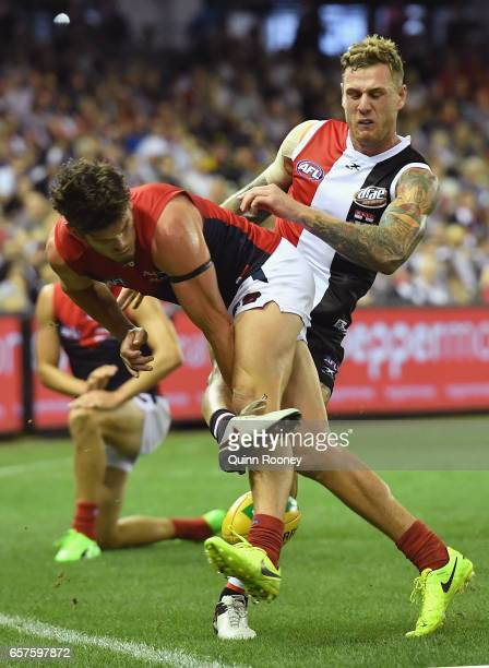 Angus Brayshaw of the Demons smouthers a kick by Tim Membrey of the Saints during the round one AFL match between the St Kilda Saints and the...