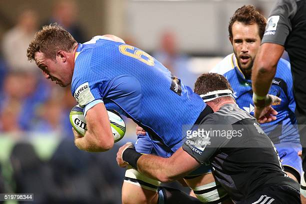 Angus Cottrell of the Force attempts to break from a tackle during the round seven Super Rugby match between the Force and the Crusaders at nib...