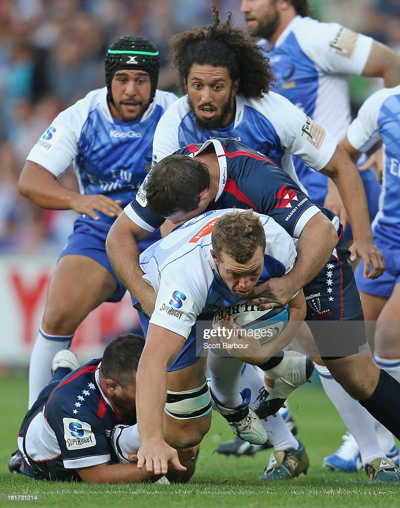Angus Cottrell of the Force is tackled during the round one Super Rugby match between the Rebels and the Force at AAMI Park on February 15, 2013 in Melbourne, Australia.