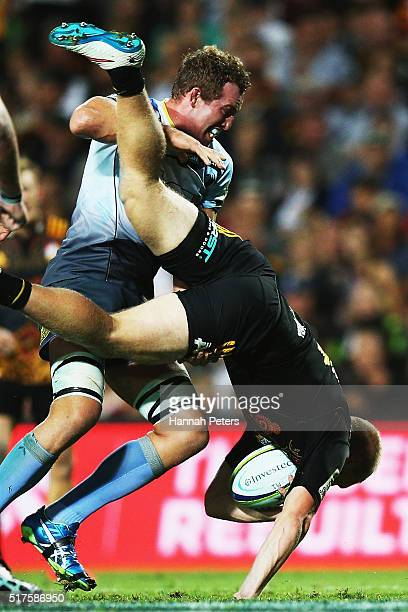 Angus Cottrell of the Force lifts Sam McNicol of the Chiefs in a tackle resulting in a yellow card during the round five Super Rugby match between...