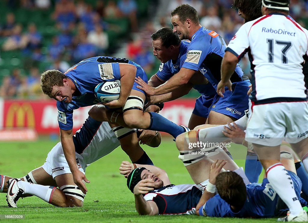 Angus Cottrell of the Force looks to break from a tackle during the round eight Super Rugby match between the Western Force and the Melbourne Rebels at nib Stadium on April 6, 2013 in Perth, Australia.