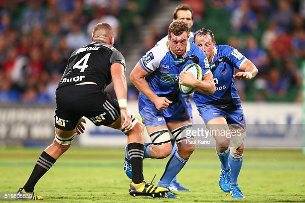 Angus Cottrell of the Force looks to break past Luke Romano of the Crusaders during the round seven Super Rugby match between the Force and the...