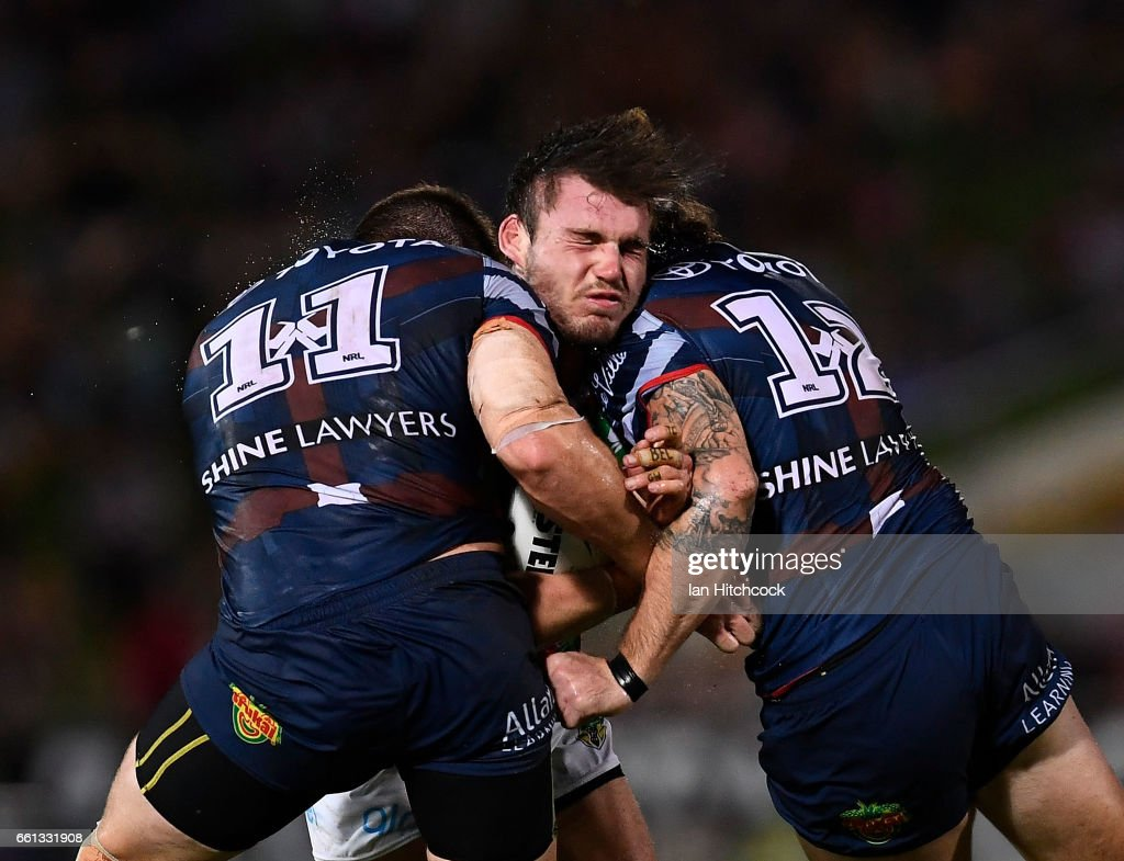 Angus Crichton of the Rabbitohs is tackled by Gavin Cooper and Ethan Lowe of the Cowboys during the round five NRL match between the North Queensland Cowboys and the South Sydney Rabbitohs at 1300SMILES Stadium on March 31, 2017 in Townsville, Australia.