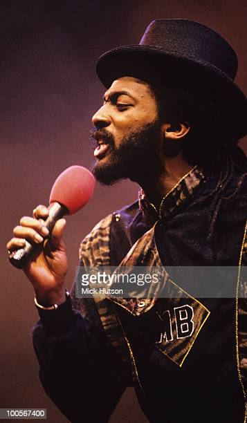 Angus 'Drummie Zeb' Gaye of reggae band Aswad performs on stage in 1990