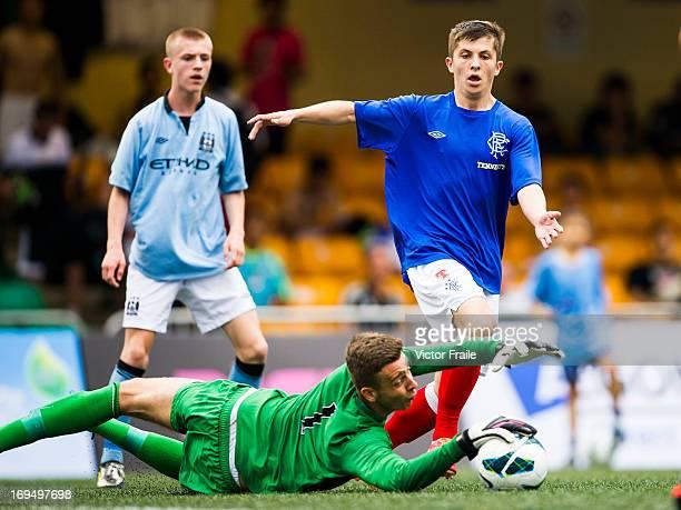 Angus Gunn of Manchester City stops a shot from Charlie Telfer of Rangers on day three of the Hong Kong International Soccer Sevens at Hong Kong...