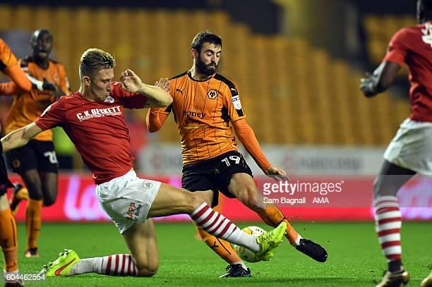 Angus MacDonald of Barnsley and Jack Price of Wolverhampton Wanderers during the Sky Bet Championship match between Wolverhampton Wanderers and...