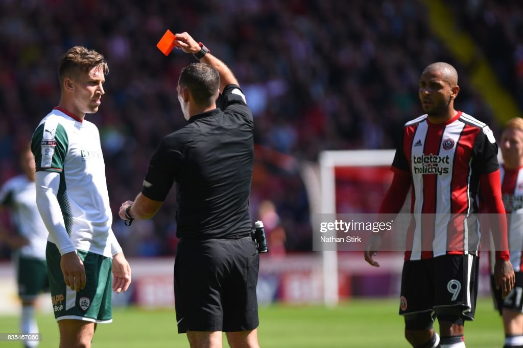 Angus MacDonald of Barnsley and Leon Clarke of Sheffield United are sent of during the Sky Bet Championship match between Sheffield United and Barnsley at Bramall Lane on August 19, 2017 in Sheffield, England.