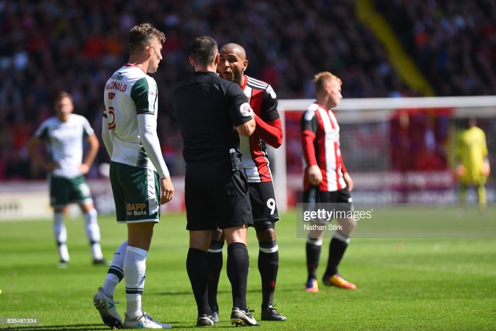 Angus MacDonald of Barnsley and Leon Clarke of Sheffield United are sent off during the Sky Bet Championship match between Sheffield United and Barnsley at Bramall Lane on August 19, 2017 in Sheffield, England.