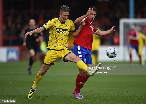 Angus MacDonald of Torquay clears the ball from Brett Williams of Aldershot during the FA Cup Qualifying Fourth Round match bteween Aldershot Town...