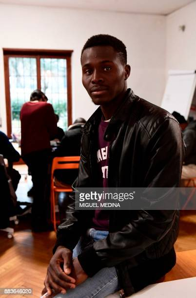Angus MACKINNON Yaya a migrant from Senegal poses at the 'LaiMomo' headquarters a vocational training programme to teach skills in leather bag making...