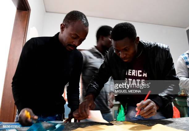 Angus MACKINNON Yaya a migrant from Senegal works on a pattern at the 'LaiMomo' headquarters a vocational training programme to teach skills in...
