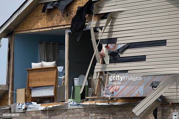 Angus Ontario JUNE 18 2014 The bedroom and bathroom of a house on Banting Crescent is exposed after a tornado ripped through the backyards of a...
