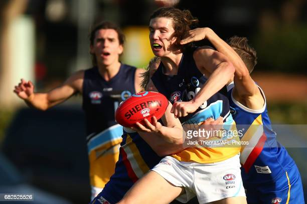Angus Schumacher of the Pioneers handballs during the round seven TAC Cup match between the Eastern Ranges and the Bendigo Pioneers at Box Hill City...