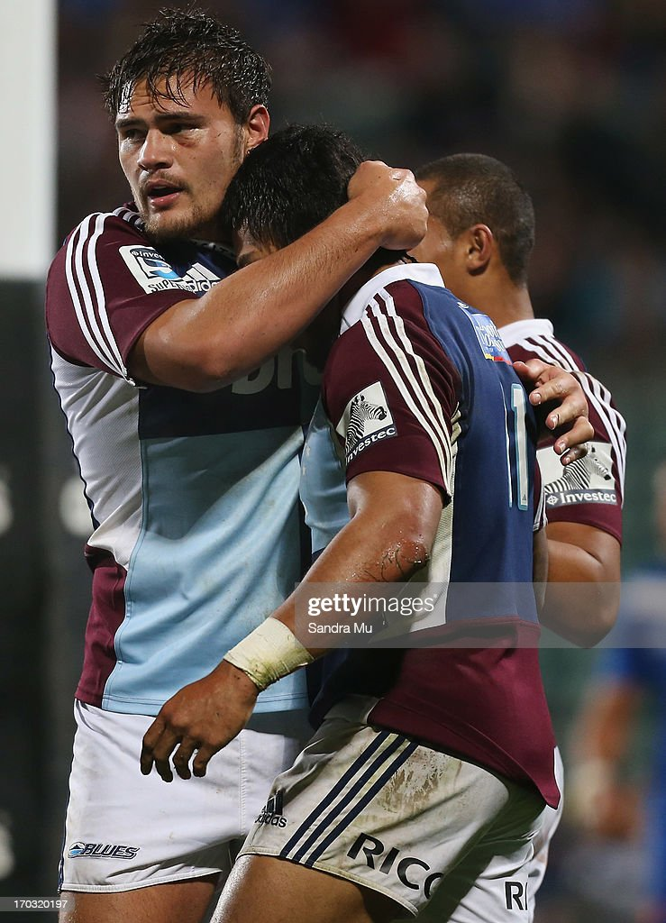 Angus Ta'avao of the Blues (L) congratulates George Moala of the Blues for his try during the tour match between the Auckland Blues and France at North Harbour Stadium on June 11, 2013 in Auckland, New Zealand.
