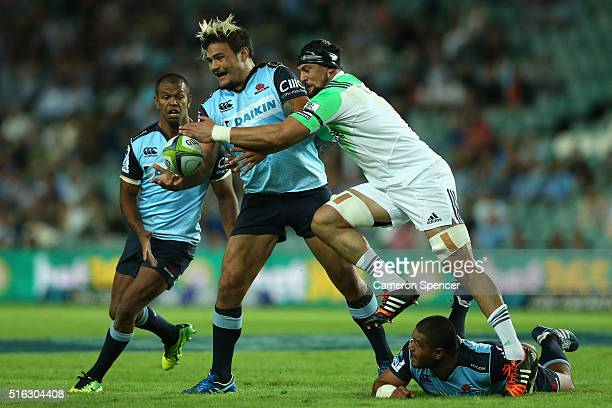 Angus Taavao of the Waratahs is tackled during the Super Rugby match between the New South Wales Waratahs and the Highlanders at Allianz Stadium on...