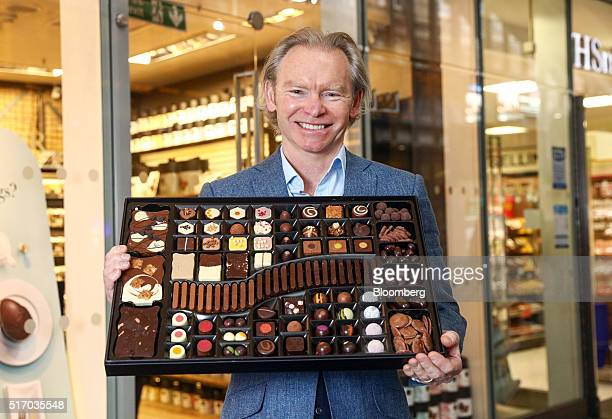 Angus Thirwell cofounder and chief executive officer of Hotel Chocolat Group Ltd holds a box of chocolate called the The Large Chocolatier's Table as...