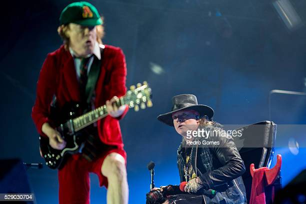 Angus Young and Axl Rose perform the first concert of the Rock or Bust tour at the Passeio Maritimo De Alges on May 7 2016 in Lisbon Portugal