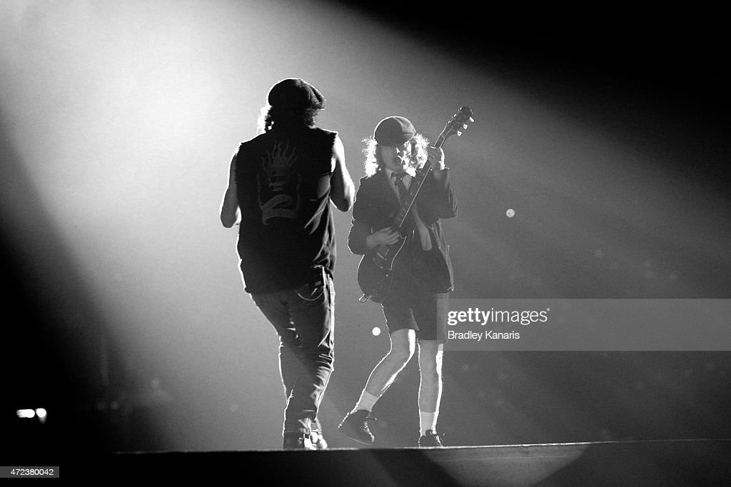Angus Young and Brian Johnson of AC/DC perform live for fans at Queensland Sport and Athletics Centre on February 25, 2010 in Brisbane, Australia.