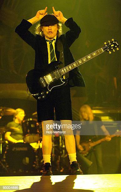Angus Young of AC/DC performs on stage doing devil horn hands on top of his head at Ahoy on March 13th 2009 in Rotterdam Netherlands