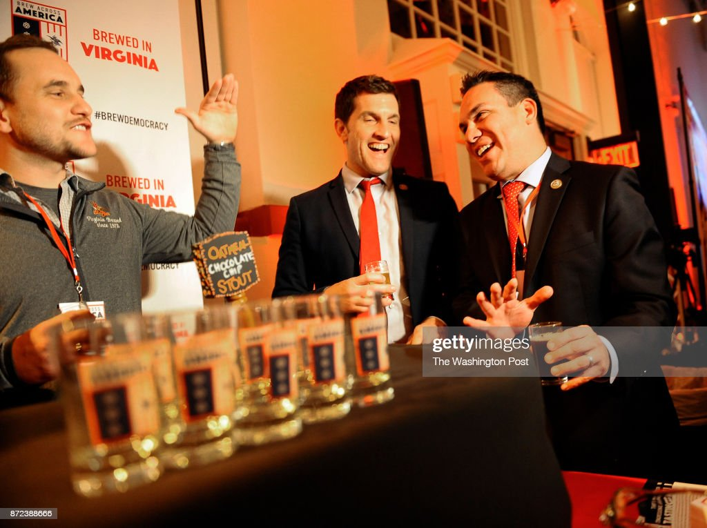 NOVEMBER 08, 2017- Anheuser Busch Williamsburg Brewery's Daren(cq) Berry(left) shared a light moment with Congressman Scott Taylor (center) and Congressman Pete Aguilar(right) at the Brew Across America event at Eastern Market on November 08, 2017 in Washington, D.C. Taylor is an Republican representing Virginias Second Congressional District and Aguilar is an Democrat representing California's 31st Congressional District.