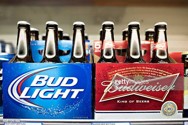 AnheuserBusch Budweiser and Bud Light brand beer sits on display for sale in a supermarket in Princeton Illinois US on Tuesday Oct 28 2014...