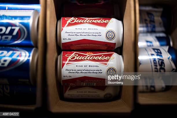 AnheuserBusch Budweiser Bud Light and Busch Light brand beers sit in a refrigerator at a bar in Princeton Illinois US on Tuesday Oct 28 2014...