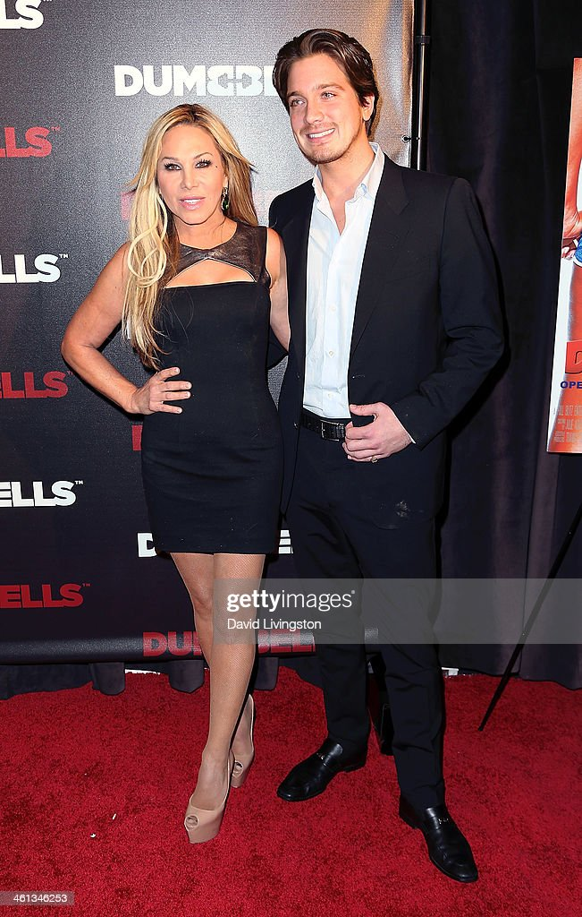 Anheuser-Busch heir Jacob Busch (R) and TV personality Adrienne Maloof attend the premiere of GoDigital's 'Dumbbells' at SupperClub Los Angeles on January 7, 2014 in Los Angeles, California.