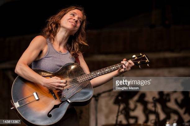 Ani DiFranco performs during the 2012 New Orleans Jazz Heritage Festival at the Fair Grounds Race Course on May 3 2012 in New Orleans Louisiana