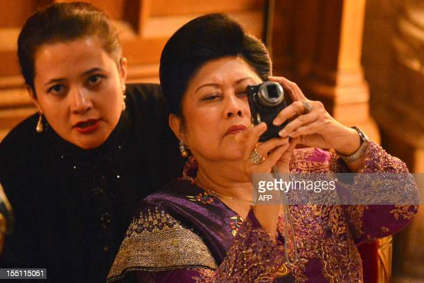 Ani Yudhoyono wife of Indonesian President Susilo Bambang Yudhoyono takes a picture on a compact camera as her husband makes a speech in the Great...