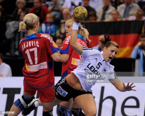 Ania Roesler of Germany is challenged by Sanja Rajovic and Slavica Koperec of Serbia during the Women's Handball World Championship qualification...