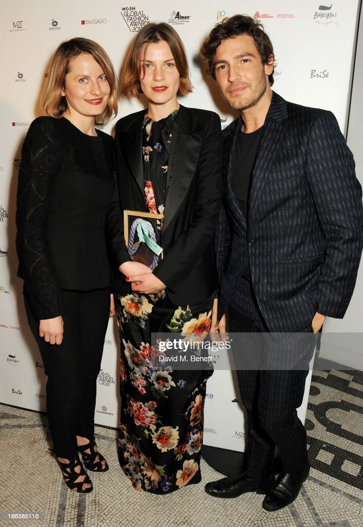 Ania Wiacek and Mia Castenskjold of Acme Studios, winners of the Menswear Design Team award, and Robert Konjic pose backstage at The WGSN Global Fashion Awards at the Victoria & Albert Museum on October 30, 2013 in London, England.