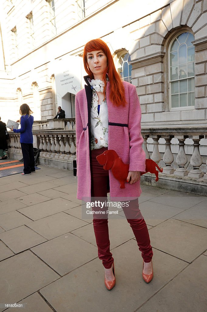 Ania Zajac, journalist and blogger at Onet, wearing coat by Ania Zajac, top by Zara, Pull and Bear jeans, accesssorised with Marni necklace from H & M, shoes from Zara, Daschund bag from the Netherlands at London Fashion Week Fall/Winter 2013/14 on February 17, 2013 in London, England.