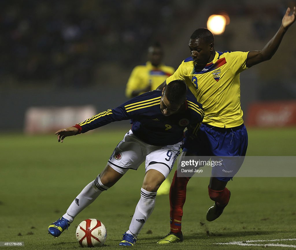 Anibal Chala of Ecuador (R) and Cristian Arango of Colombia during a U18 match between Colombia and Ecuador as part of the XVII Bolivarian Games Trujillo 2013 at Mansiche Stadium on November 21, 2013 in Lima, Peru.