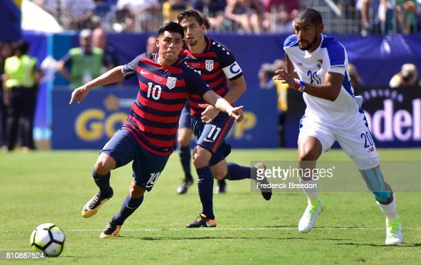 Anibal Godoy of Panama chases Joe Corona of USA during the first half of a CONCACAF Gold Cup Soccer match at Nissan Stadium on July 8 2017 in...