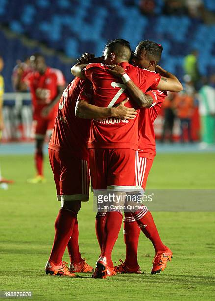Anibal Hernandez of Amereica de Cali celebrates with teammates after scoring the second goal of his team during a match between America de Cali and...