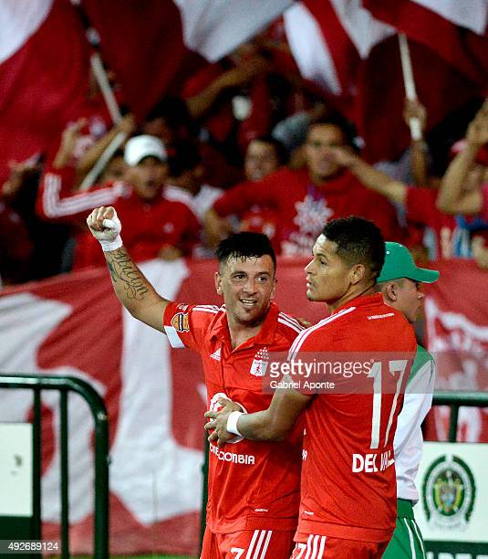 Anibal Hernandez of America de Cali celebrates after scoring the first goal of his team during a match between Deportes Quindio and America de Cali...