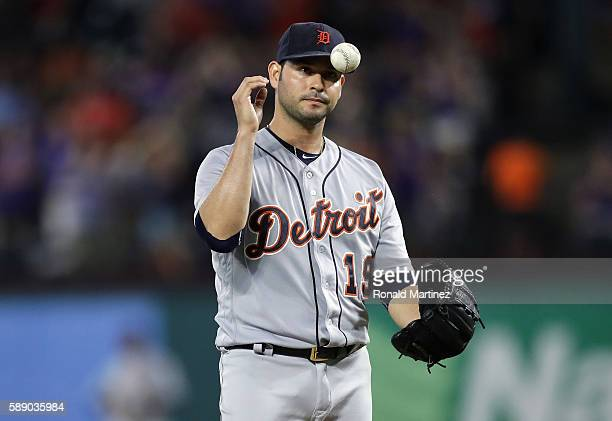 Anibal Sanchez of the Detroit Tigers reacts after giving up a tworun homerun against Jonathan Lucroy of the Texas Rangers in the third inning at...