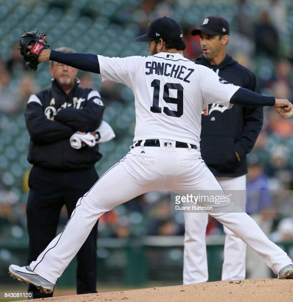Anibal Sanchez of the Detroit Tigers throws a pitch while being watched by trainer Kevin Rand and manager Brad Ausmus of the Detroit Tigers after...